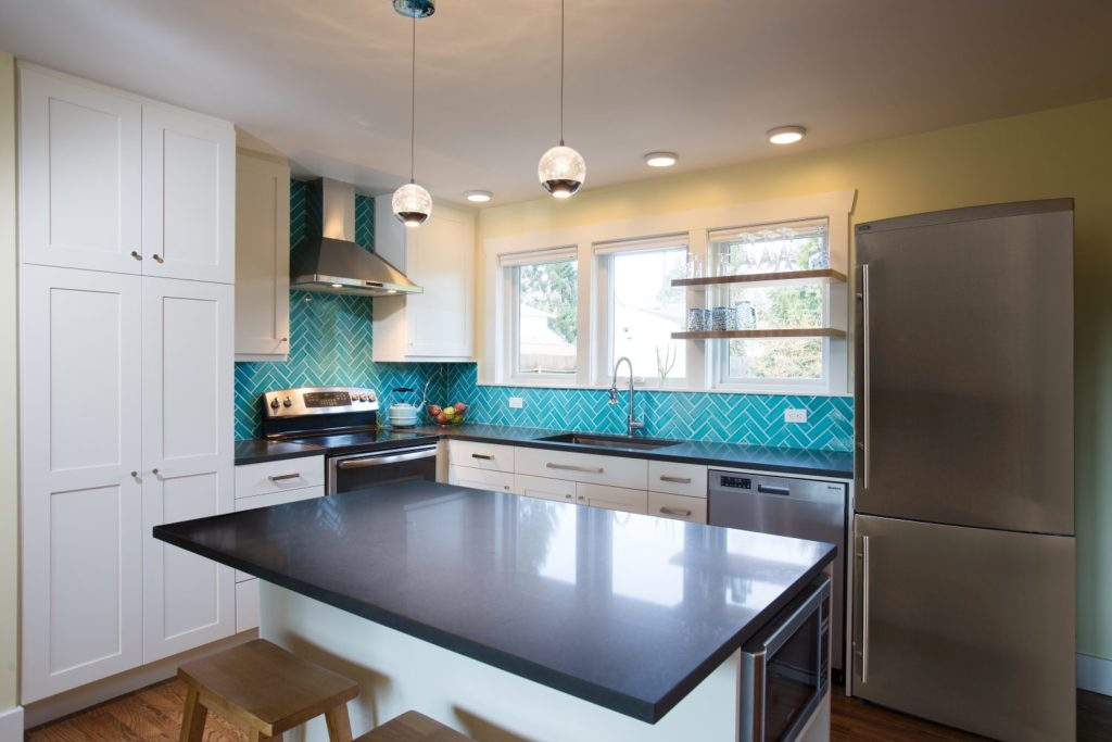 Kitchen with teal backsplash
