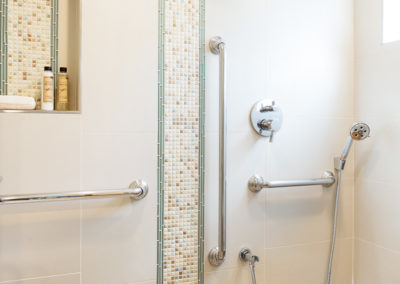 Tiled bathroom with handicap accessible bars