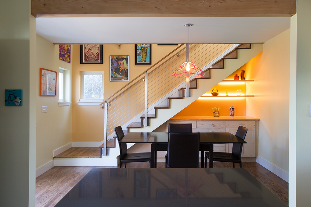 dining room with stairs and orange walls